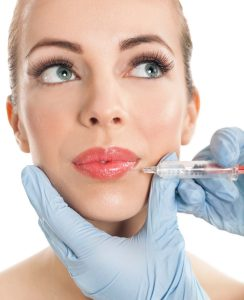 Botox shot in the female cheek